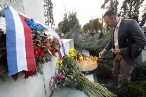 epa05025165 People place flowers and light candles in tribute for the victims of the 13 November Paris attacks, in Belgrade, Serbia, 14 November 2015. At least 120 people have been killed in a series of attacks in Paris on 13 November, according to French officials. Eight assailants were killed, seven when they detonated their explosive belts, and one when he was shot by officers, police said. French President Francois Hollande says that the attacks in Paris were an 'act of war' carried out by the Islamic State extremist group.  EPA/KOCA SULEJMANOVIC