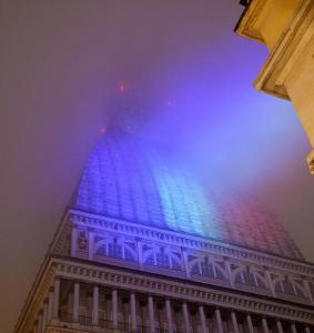 """The """"Mole Antonelliana"""" coulored with France flag while people gather in a solidarity rally with the French people in the aftermath of the Paris terror attacks, in Turin, Italy, 14 November 2015. French police on Saturday hunted possible accomplices of eight assailants who terrorized Paris concert-goers, cafe diners and soccer fans with a coordinated string of suicide bombings and shootings in France's deadliest attacks. At least 120 people have been killed in a series of attacks in Paris, France on late 13 November 2015. ANSA/ALESSANDRO DI MARCO"""