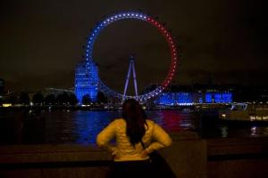 The London Eye ferris wheel is lit up in the colors of the French flag in solidarity with France after the deadly attacks in Paris, in London, Saturday, Nov. 14, 2015. French President Francois Hollande said more than 120 people died Friday night in shootings at Paris cafes, suicide bombings near France's national stadium and a hostage-taking slaughter inside a concert hall. (ANSA/AP Photo/Matt Dunham)
