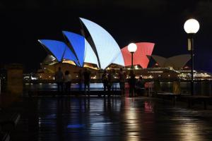 epa05024432 The Sydney Opera House is illuminated in the French national colours in tribute for the victims of the 13 November Paris attacks, in Sydney, Australia, 14 November 2015. At least 120 people have been killed in a series of attacks in Paris on 13 November, according to French officials. Eight assailants were killed, seven when they detonated their explosive belts, and one when he was shot by officers, police said.  EPA/DAN HIMBRECHTS AUSTRALIA AND NEW ZEALAND OUT